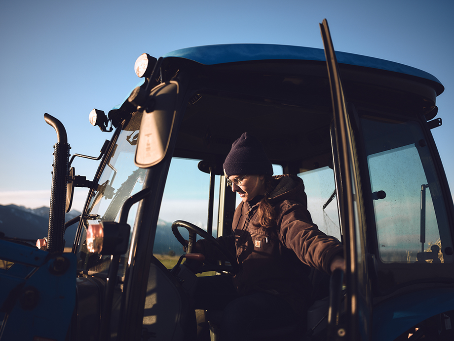 Amy driving a tractor. Photograph by Kody Kohlman