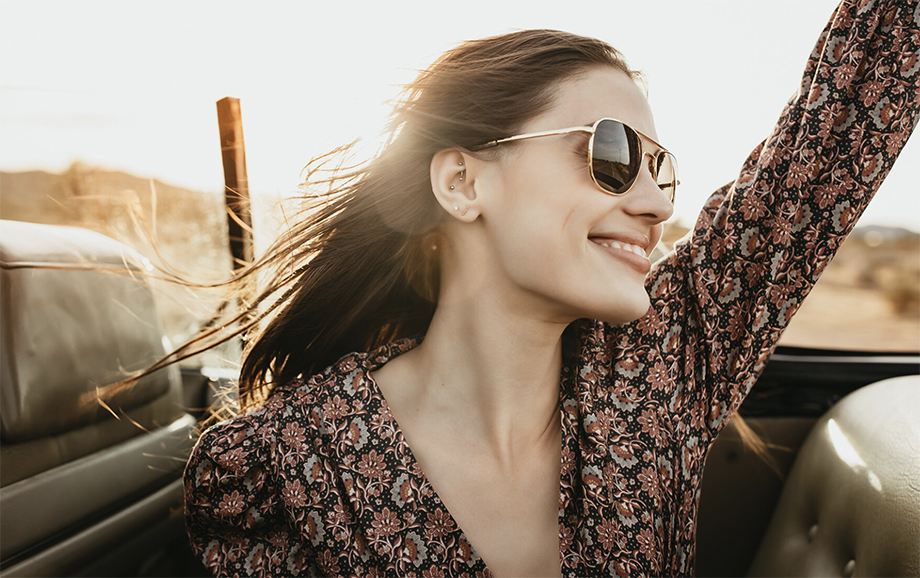 A model wearing American Optical's sunglasses while projecting a fun, care-free attitude. Photographed by Marissa Roseillier for American Optical.