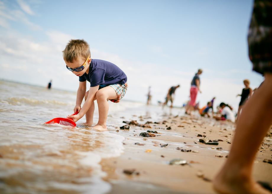 Young boy sifting through the sand for Matthew Rakola's personal series My Former Future Self