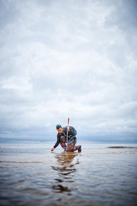 Fossil Hunter on the shore. Photographed by Matthew Rakola.