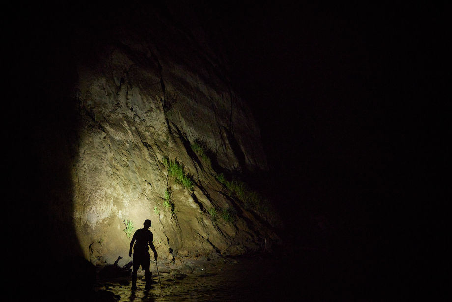 Fossil hunter searching at night with a headlamp.