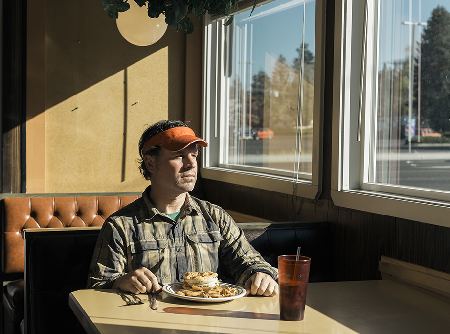 Rue McKenrick in a diner in Bend, Oregon. Photographed by Michael Hanson for Backpacker Magazine.