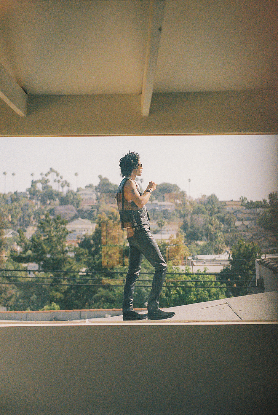 Model on roof shot from inside house by Michael Julius for New Republic footwear Sonoma campaign