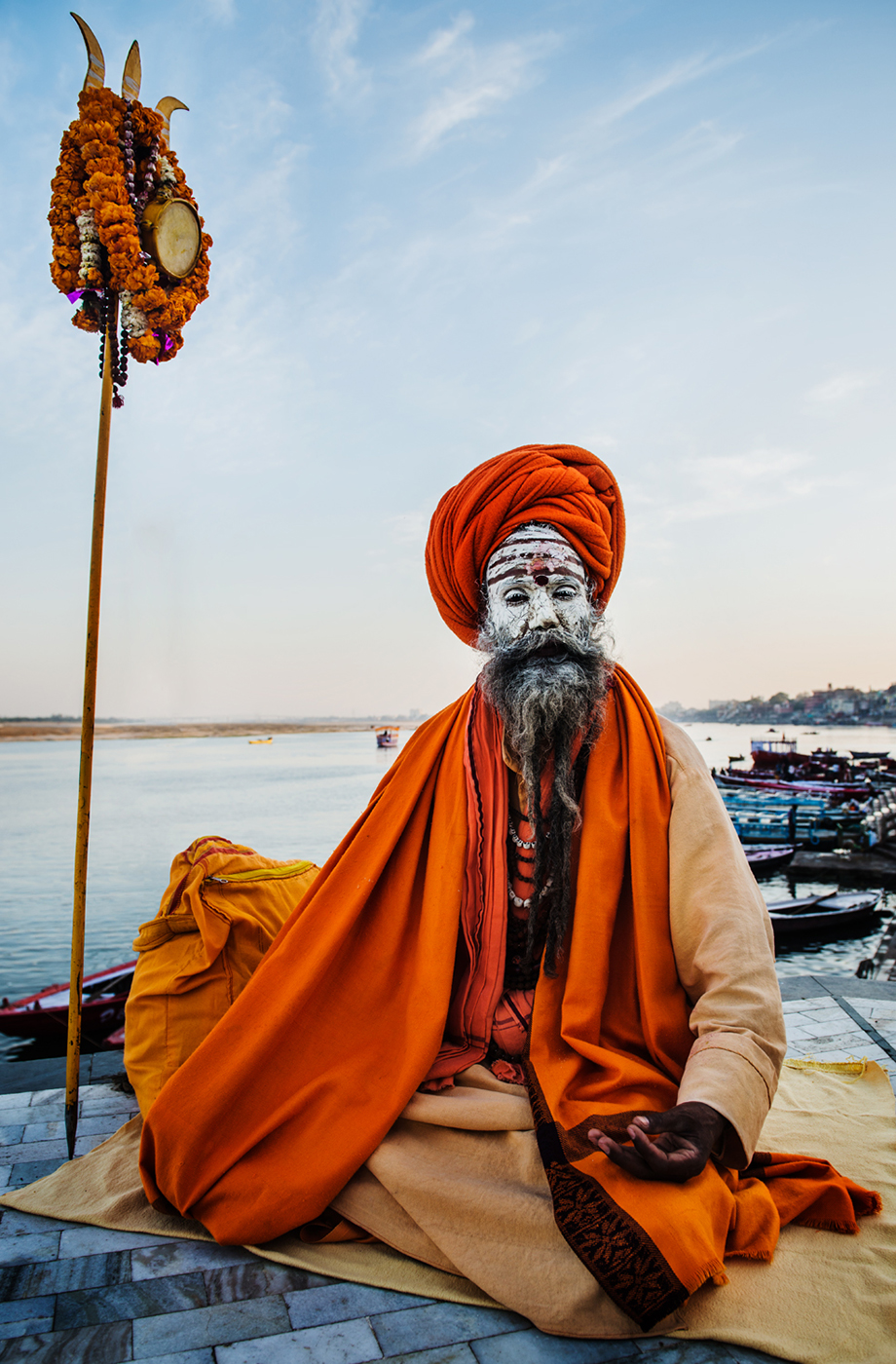 Praying man at Hindu temple on the Ganges in Varanasi shot by Michael Marquand for Lodestars Anthology