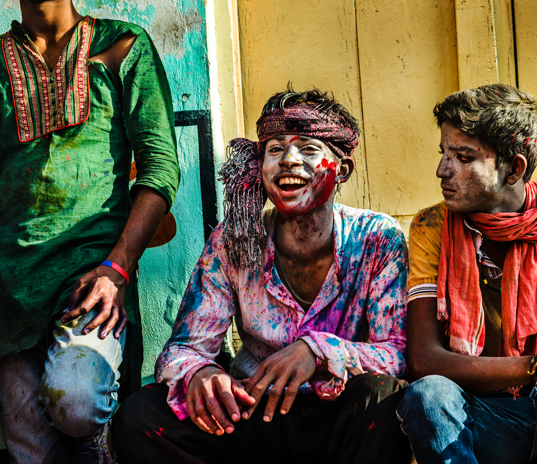 Three men in left over paint from Holi festival shot by Michael Marquand for Lodestars Anthology
