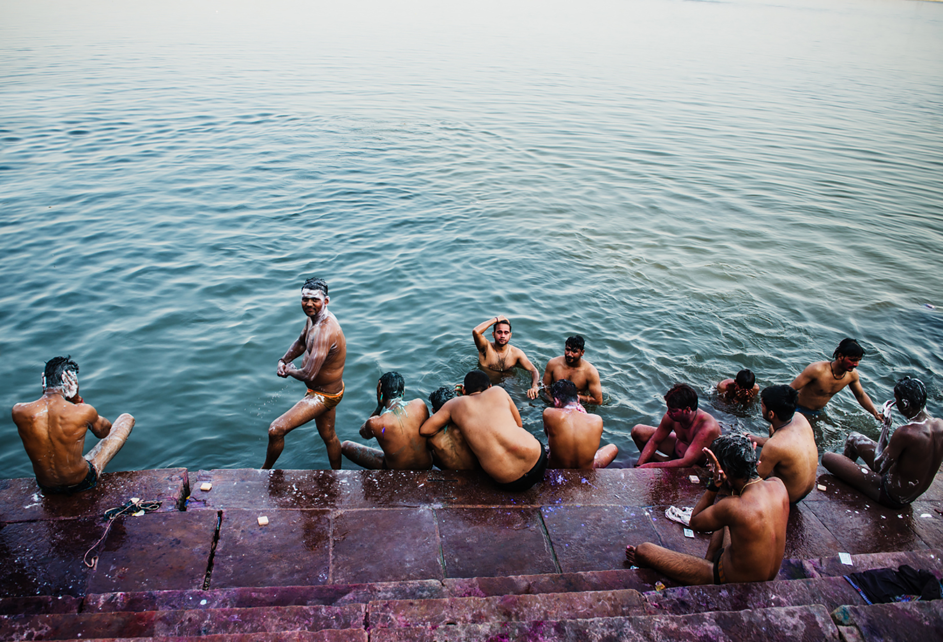 A group of men rinse off the dyes of Holi festival in the Ganges shot by Michael Marquand for Lodestars Anthology