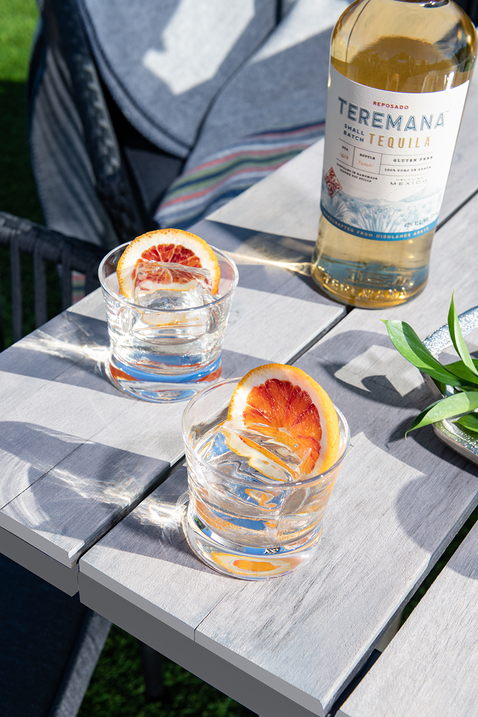 Two glasses filled with Teramana tequila and orange slices shot by Morgan Ione