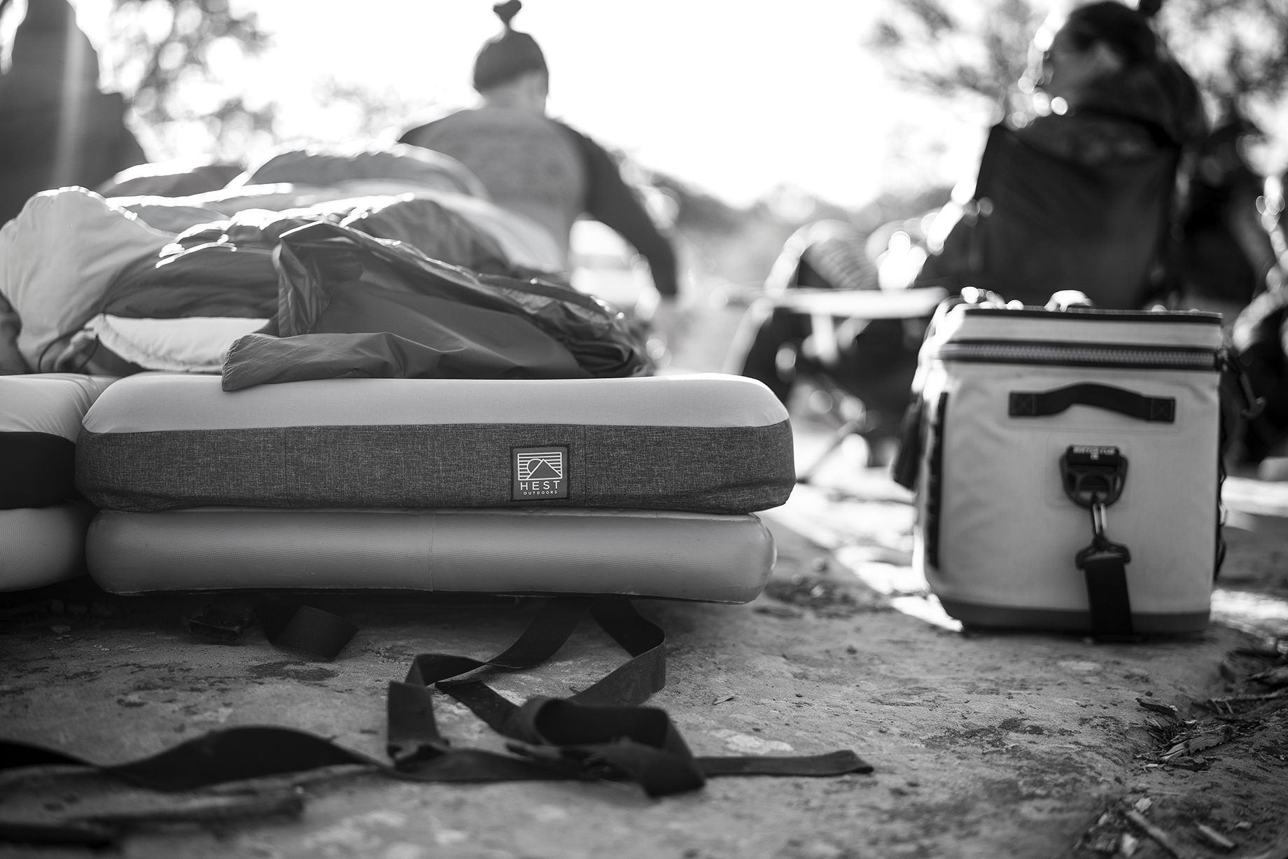 Black and white images of Hest mattress atop a rocky terrain in the Moab desert shot by Motofish