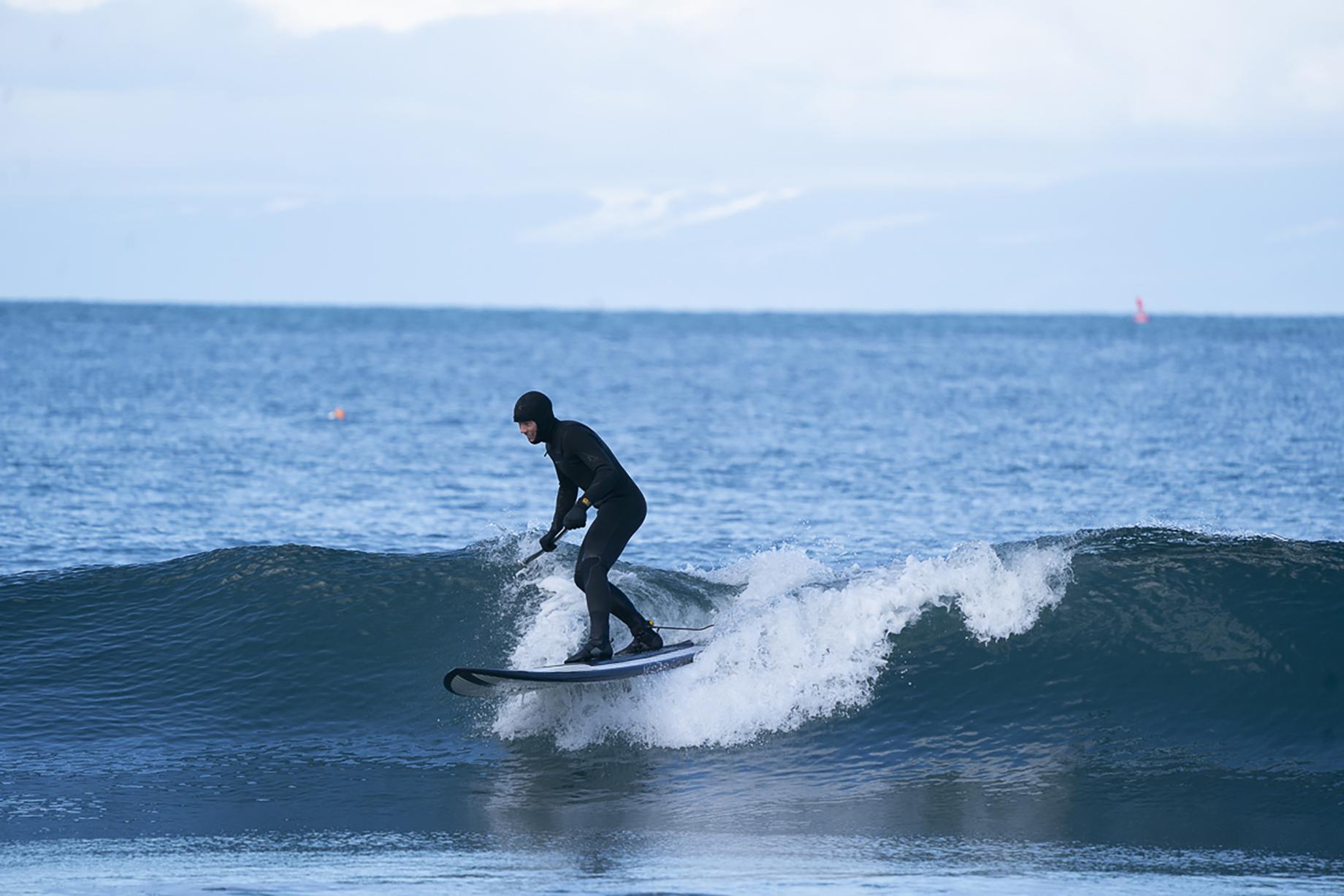 Man in wetsuit surfing on Washington coast shot by Motofish for Hest