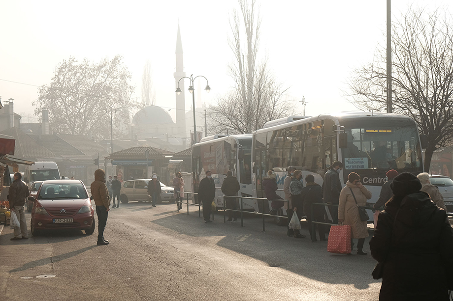 Sarajevans wait at a bus stop on a day when Sarajevo ranked among the most polluted cities in the world with an AQI rating of over 300. Photography by Nick St. Oegger.