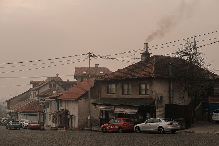 Smoke billows from the chimney of a bakery during a heavily polluted day in Sarajevo. Widespread burning of wood, poor quality coal, tires, plastic and rubbish contribute to periods of poor air quality during the winter.Photography by Nick St. Oegger.