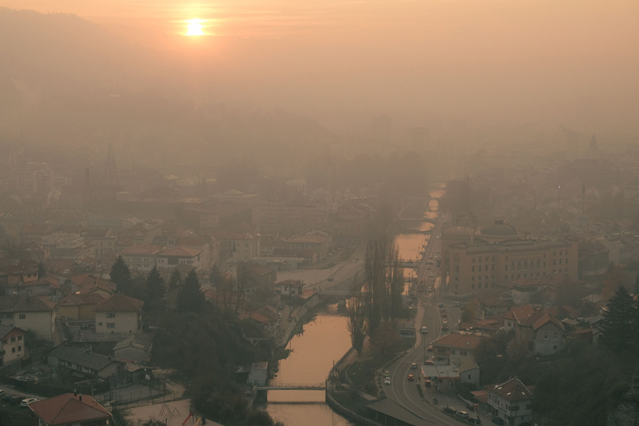 Smog hangs over Sarajevo on a heavily polluted winter day. The city's geography, located in a basin surrounded on all sides by mountains that make up part of the Dinaric Alps, contributes to often lengthy periods of poor air quality during winter months.Photography by Nick St. Oegger.