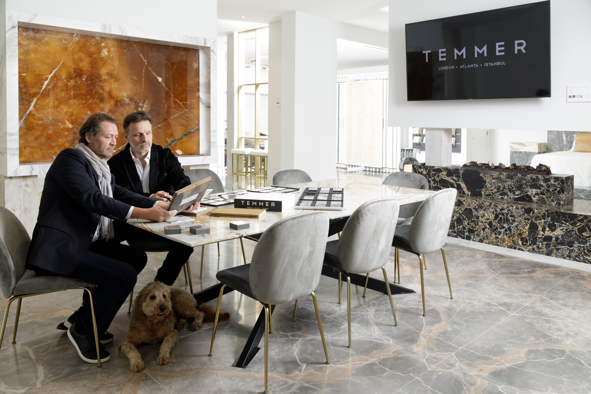 Patrick Heagney photographs two sophisticated designers and their dog surrounded by Temmer Marble