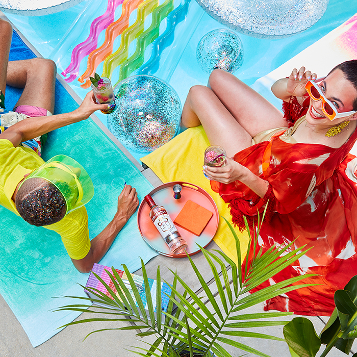 Colorful pool side Pride celebration. Photographed by Paul Quitoriano for Smirnoff.