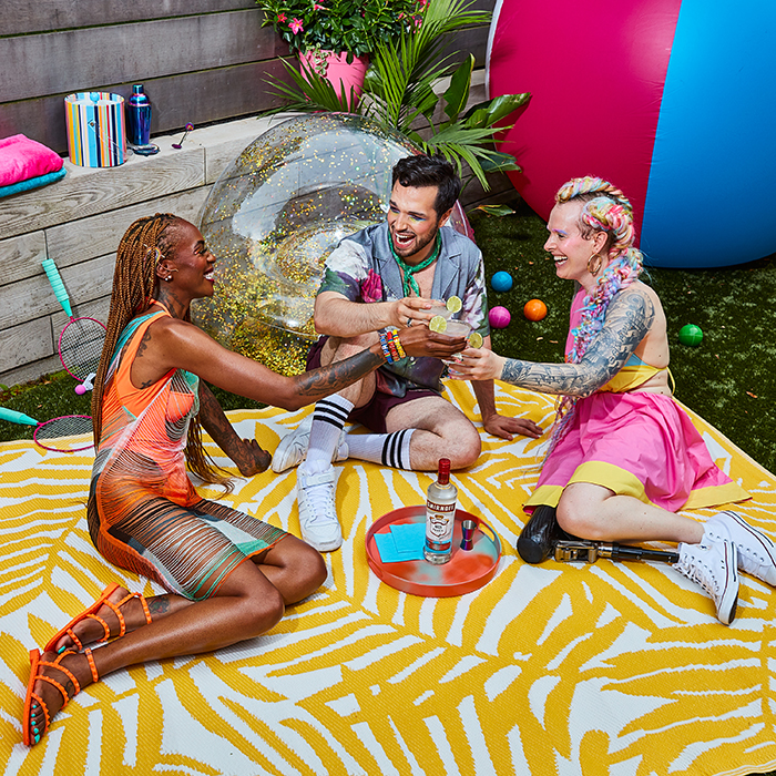 A trio toasting to pride. Photographed by Paul Quitoriano for Smirnoff.