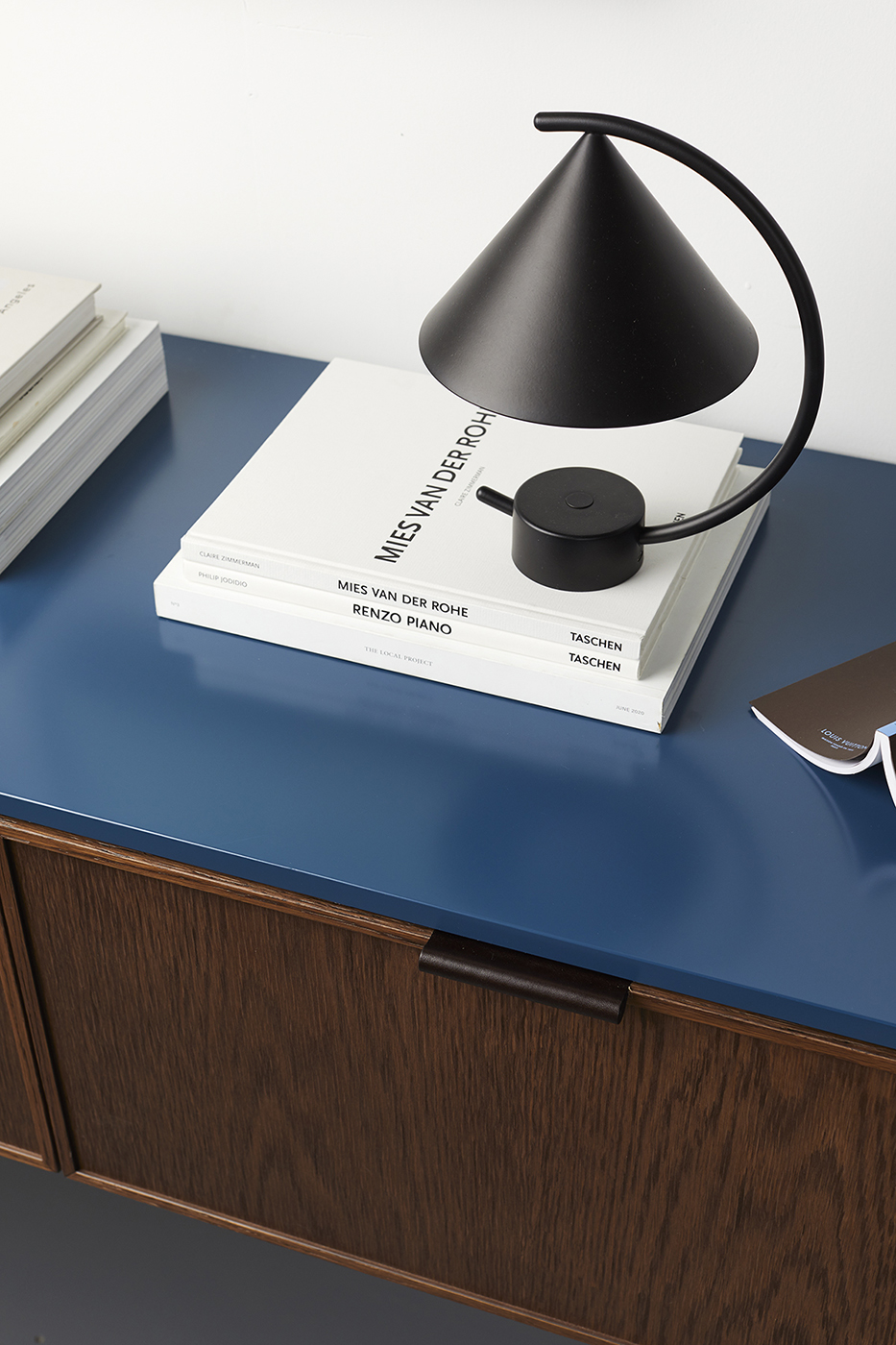 Blue topped wood grain cabinet with black modern hardware made by Ensemble furniture shot by Peter Tarasiuk