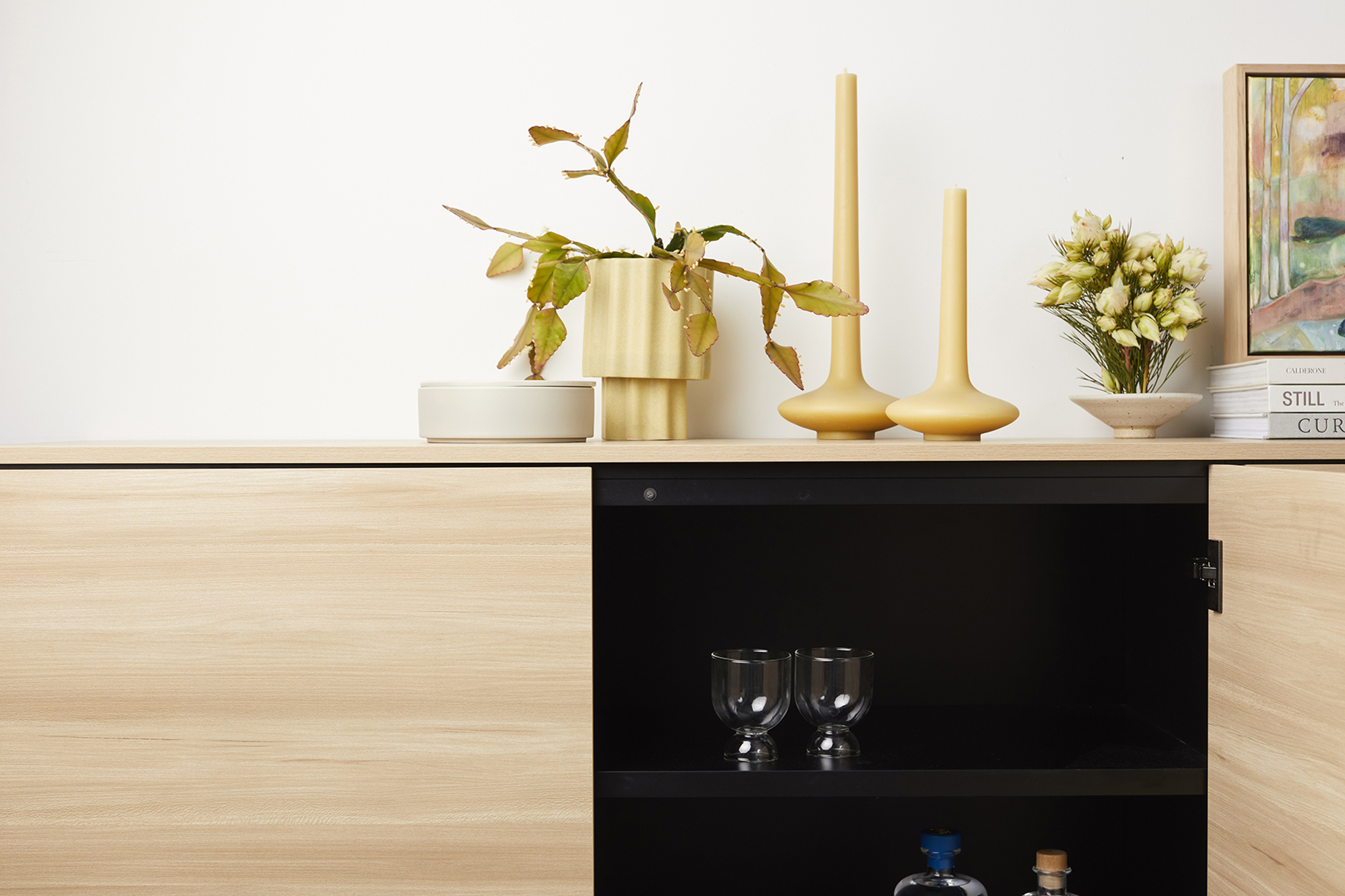 Light wood cabinet open to black interior made by Ensemble furniture shot by Peter Tarasiuk