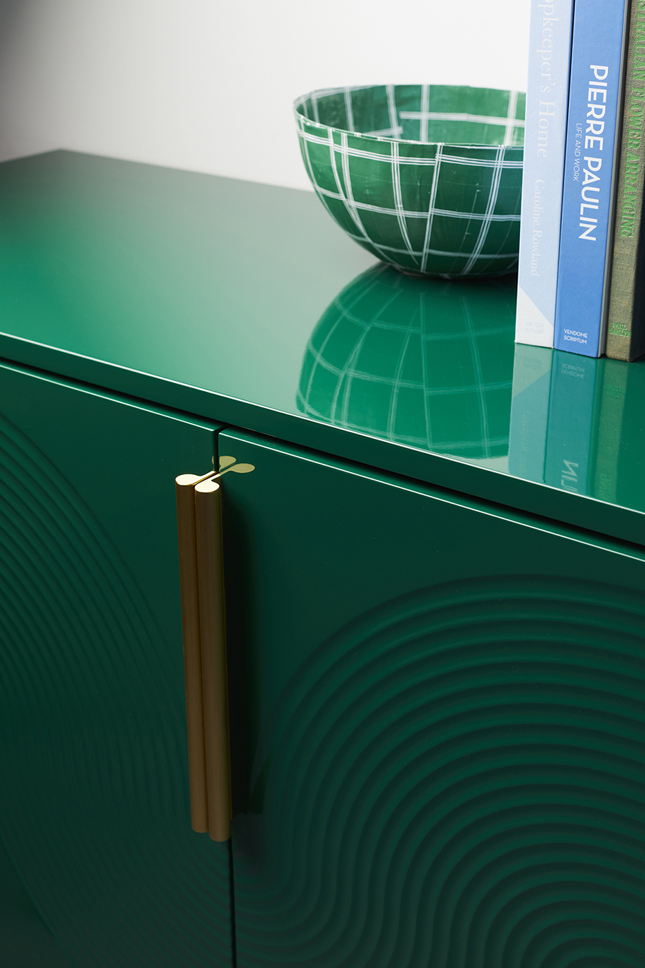 Bright green cabinet with arched details and gold hardware made by Ensemble furniture shot by Peter Tarasiuk