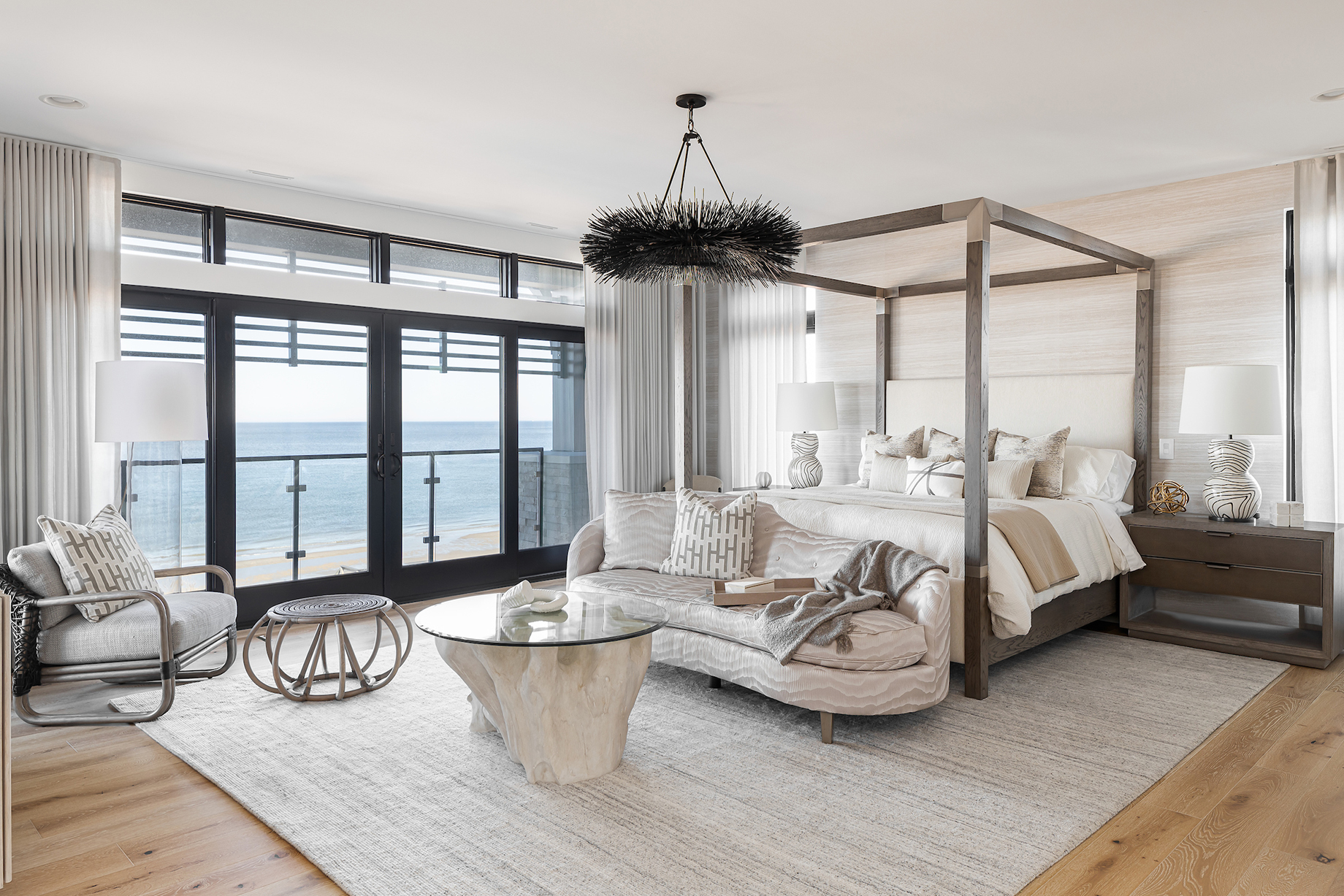 Bedroom with oceanside view in Virginia Beach home designed by Kenneth Byrd.