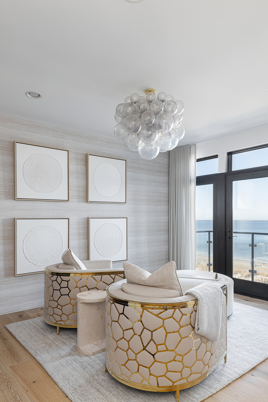 Bedroom chairs facing oceanside view in Virginia Beach home designed by Kenneth Byrd shot by Quentin Penn Hollar for Virginia Living Magazine