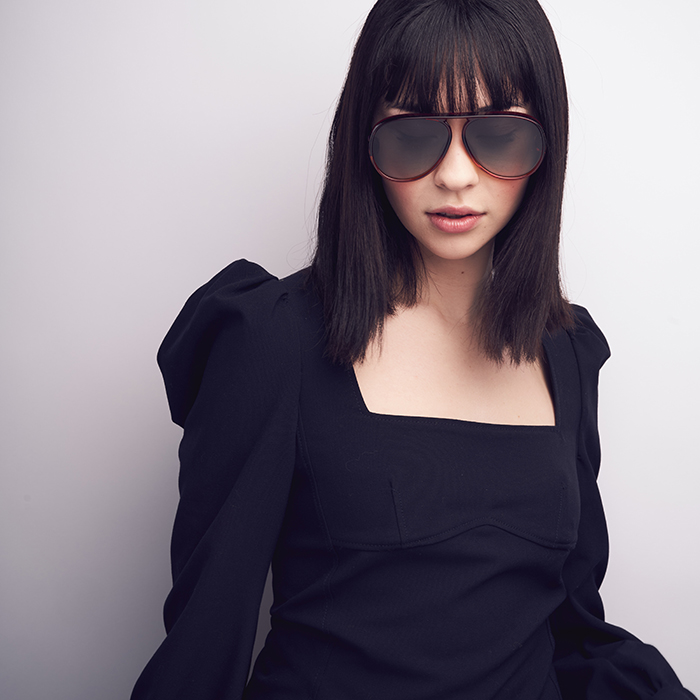 Richard Schmon photographs a model poses with Kits.com glasses.