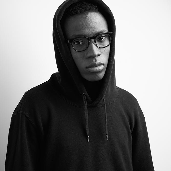 Richard Schmon photographs a black and white portrait of a male model wearing kits eyewear.