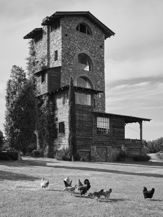 Black and white exterior shot of stone  house shot by Rob Culpepper for Barrett Austin's book Of Common Origin