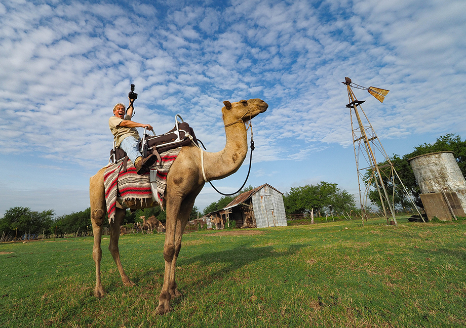 Scott Van Osdol rides a camel for the first time.