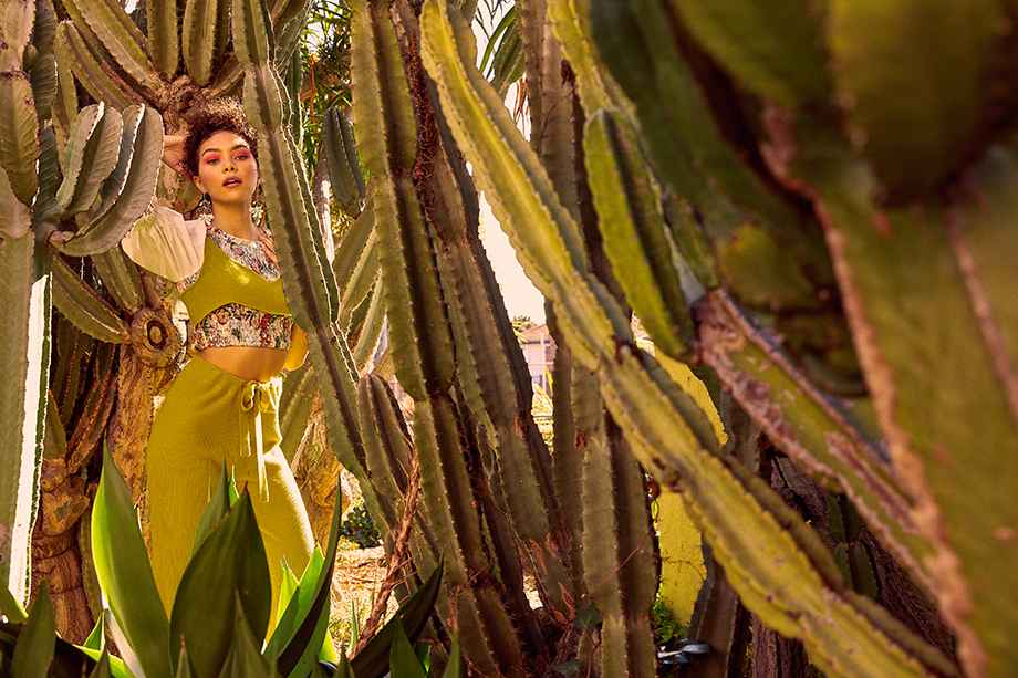 A model poses in a cactus garden.  Photographed by Sean Scheidt for Girls Life Magazine.