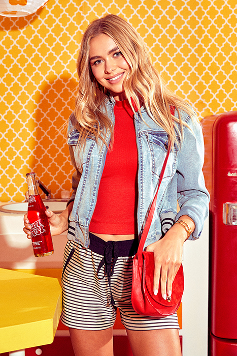 A young model holding a soda bottle photographed by Sean Scheidt for Girls Life Magazine.