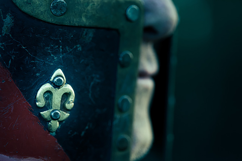 A close up of the details on a medieval helmet worn by a member.  Photographed