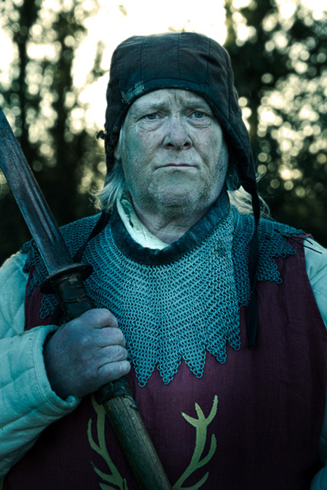 A member of the Legion of the Stag holds a sword. Photographed by Simon Plant.