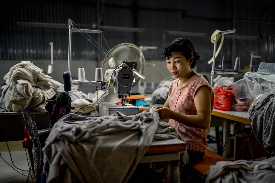 A Zilingo factory worker in Hanoi, Vietnam. Photography by Tim Gerard Barker.