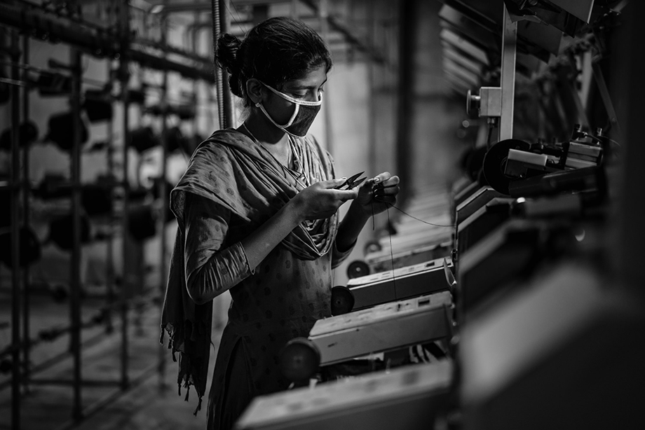 A worker lit with a small LED panel. Photography by Tim Gerard Barker.