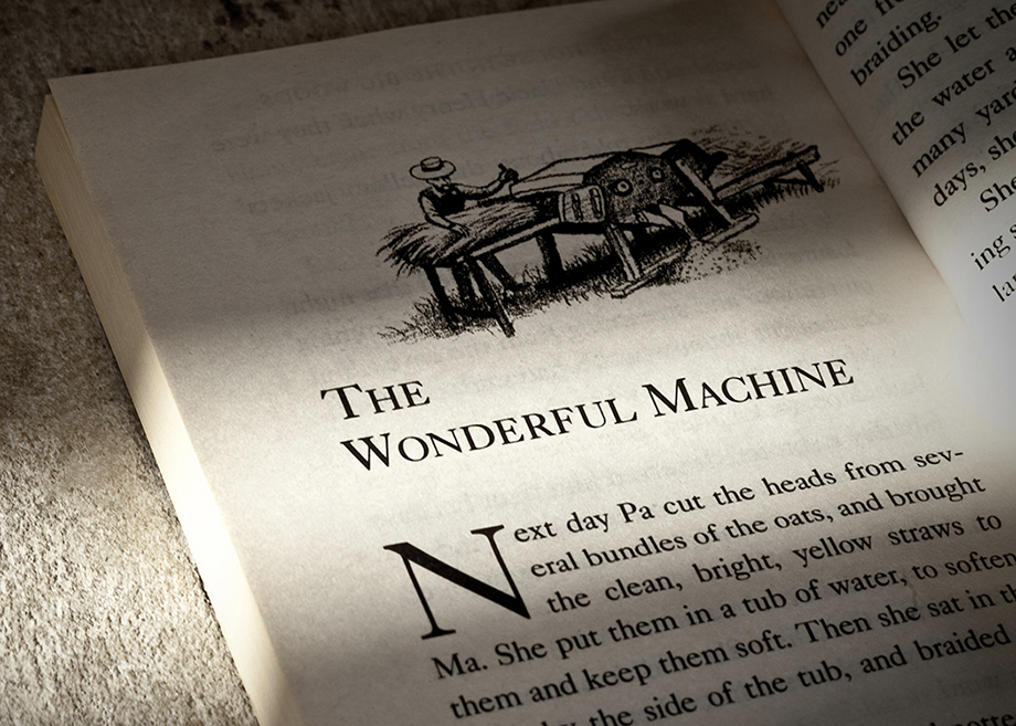 Opening page of the chapter The Wonderful Machine in the book Little House in the Big Woods by Laura Engels Wilder.