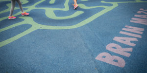 feet running through maze painted on concrete