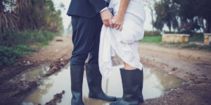 bride and groom in rainboots and puddle