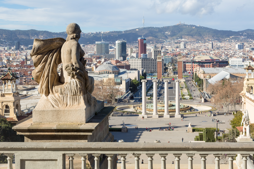 barcelona-View from Montjuic to Plaza de Espana including the four columns and the venetian towers_383291470