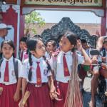 Balinese kids in school uniform_286240091
