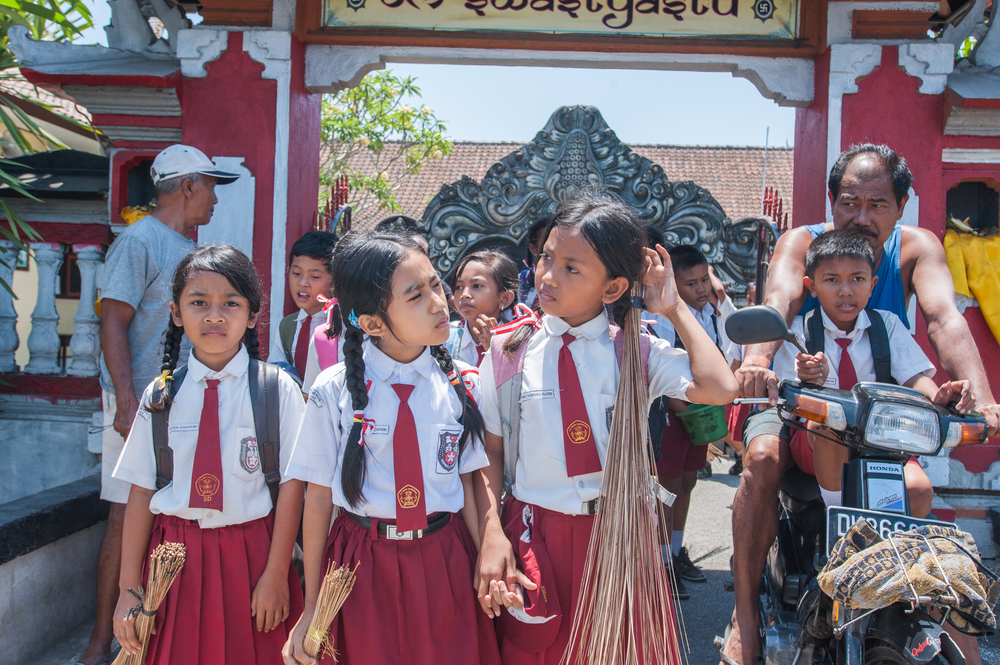 Balinese kids in school uniform_286240091