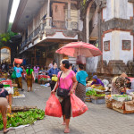 Balinese woman in market sell fruits_165482480