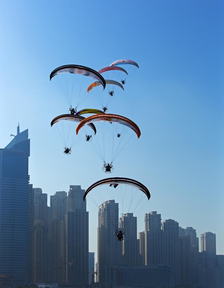 Paragliders over Dubai marina_255560398