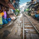 railway running along narrow street_248554360