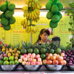 Vietnamese girl serving fresh tropical fruit juice_334104605