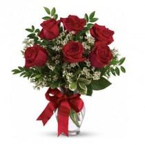 6 rosas. Florero incluido.