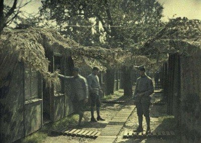 Sheds, camouflage and French soldiers. Rexpoede.