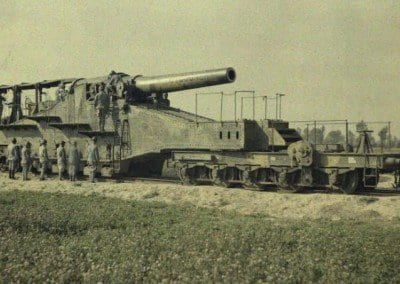 "Artillery piece of the 320th. Artillery piece,""Cyclone "", and its escort on rail"
