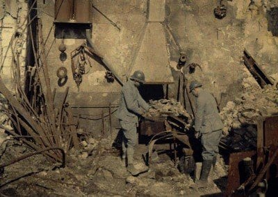 Engineers in a destroyed mill