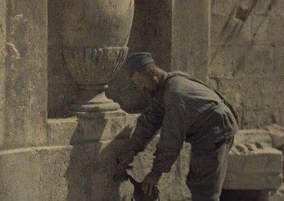 Soldier at fountain getting water