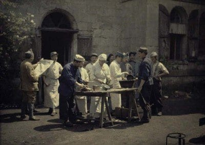 The cooks of the hospital preparing the meat outside.